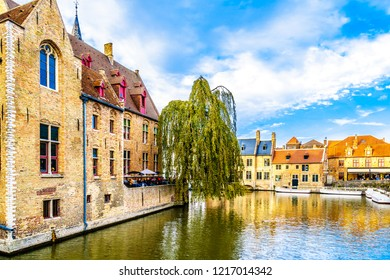 Brugge/Belgium - Sept. 18 2018: Canal scene with surrounding medieval buildings in the medieval city of Bruges, Belgium