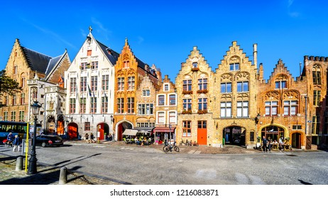 Brugge/Belgium - Sept. 189 2018: Historic brick houses with step gables at the Jan Van Eyck Square in the center of Bruges, Belgium