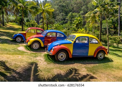 BRUMADINHO, BRAZIL - Oct 14, 2015: Colored cars of Troca-Troca by Jarbas Lopes at Inhotim Public Contemporary Art Museum - Brumadinho, Minas Gerais, Brazil