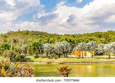 BRUMADINHO, BRAZIL - OCTOBER, 15, 2017: Lake at at Inhotim Institute with Invention of Colour Penetrable Magic Square by Helio Oiticica in background, Minas Gerais