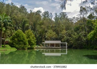 BRUMADINHO, INHOTIM, MINAS GERAIS/BRAZIL - FEBRUARY 2013: Inhotim Tunga True Rouge pavillion and lake with building reflection, Brumadinho, Minas Gerais/Brazil.