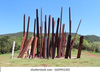 "Brumadinho/Minas Gerais/Brazil - November 17, 2019: ""Beam drop Inhotim"" is an art work by Chris Burden, made in 2008 for the Inhotim Museum. It consists in several steel bars sunk in a concrete pool."