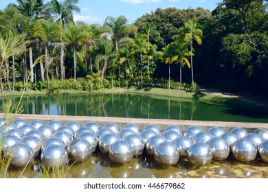 Brunadinho, Inhotim, Minas Gerais, Brazil - February 2016: Yayoi Kusama Narcissus garden, stainless steel balls on water in the Inhotim Inhotim public contemporary art museum founded by Bernardo Paz