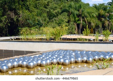 Brunadinho, Inhotim, Minas Gerais, Brazil - February 2016: Yayoi Kusama Narcissus garden, stainless steel balls on water in the Inhotim Inhotim public contemporary art museum founded by Bernardo Paz