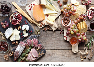Brunch. Appetizers table with various of cheese, curred meat, sausage, olives, nuts and fruits. Festive family or party snack concept. Overhead view.
