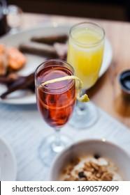 Brunch cocktails mimosas orange cranberry - Shutterstock ID 1690576099