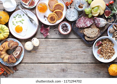 Brunch. Thanksgiving Day family breakfast or brunch set served on rustic wooden table. Overhead view, copy space