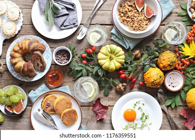 Brunch.Thanksgiving breakfast or brunch set, meal variety with fried egg, pancakes, granola, sweets and berries. Overhead view