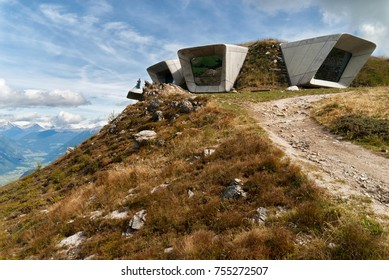 Bruneck, Italy - September 7, 2017: Backside of Messner Mountain Museum Corones (Mount Kronplatz, Dolomites) desgined by Zaha Hadid and paraglider
