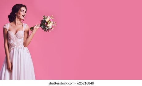 Brunet bride portrait in pink studio