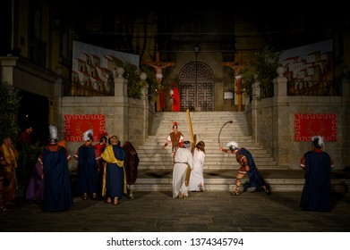 Brunete, Spain - April 11, 2019: Popular play of The Passion of Christ in the Plaza Mayor of the town. Climb to the Golgotha of Jesus with the Cross.