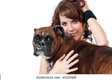 Brunette beauty poses with her pet dog, a pedigreed Boxer.