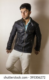 Brunette boy Isolated inside Studio with black jacket
