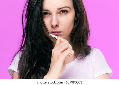 brunette brush your teeth on a pink background