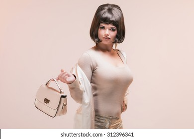 Brunette Business Woman in Pink Retro 1960s Fashion.