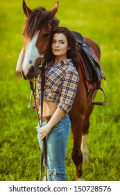 brunette cowgirl woman posing with horse outdoors portrait