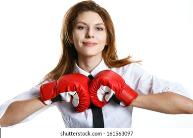 Brunette european woman is ready to kick ass / smiling woman with red boxing gloves on a white background