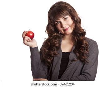 Brunette girl with apple in hand. Studio shot.