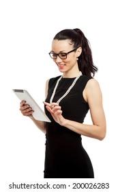 brunette girl in black dress holding ipad over white background