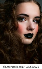 Brunette girl with black lips and blush