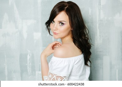 Brunette girl with bright make-up and permanent, portrait