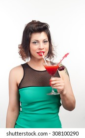 brunette girl with a cocktail and fruit alcohol