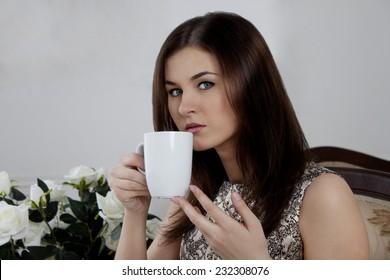 Brunette girl. coffee drinking tea. smile sexy