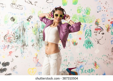 brunette girl dancing and listening music