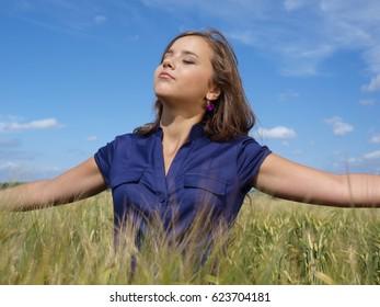 brunette girl enjoying the sun in a field
