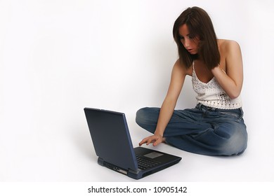 brunette girl with laptop on white background