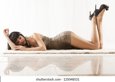 Brunette girl laying on the flor