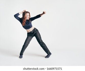 brunette girl shows dance elements on a white background