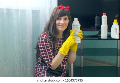 Brunette girl washes TV, domestic