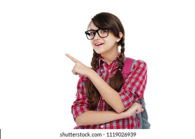 Brunette girl wearing glasses pointing to the white background