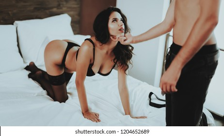 Brunette Girl. Woman in Black Lingerie. Woman on Bed. White Linens. Undressed Girl in Room. Beautiful Brunette Famale. Man Topless. Woman in Lingerie and Stockings. Sex Games. Sexy Girl in Lingerie.