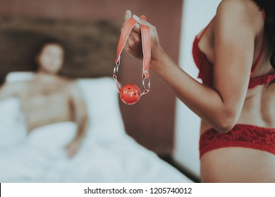 Brunette Girl. Woman in Red Lingerie. Girl Young. White Linens. Man Topless. Woman in Lingerie and Stockings. Sex Games. Man on Bedroom. Girl with Woman with Sex Toy on Hand. Woman with Sex Toy.