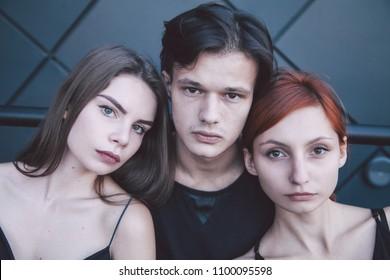 brunette guy, red girl and brunette girl