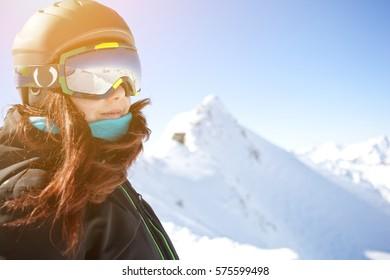 Brunette in helmet among mountains