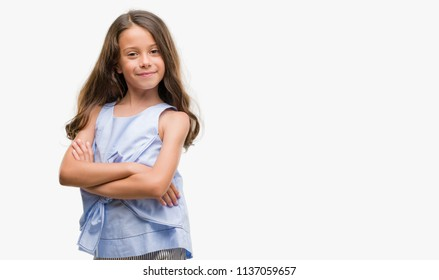 Brunette hispanic girl happy face smiling with crossed arms looking at the camera. Positive person.