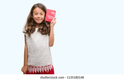 Brunette hispanic girl holding passport of Switzerland with a happy face standing and smiling with a confident smile showing teeth