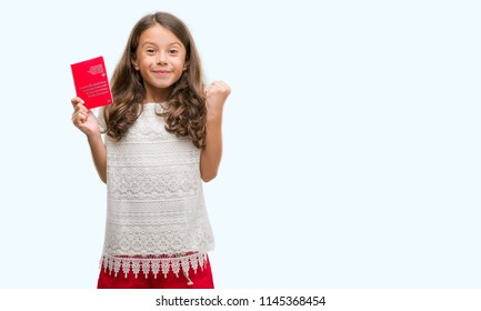 Brunette hispanic girl holding passport of Switzerland screaming proud and celebrating victory and success very excited, cheering emotion