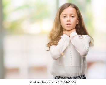 Brunette hispanic girl shouting and suffocate because painful strangle. Health problem. Asphyxiate and suicide concept.