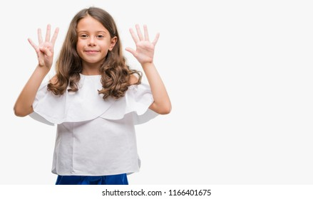 Brunette hispanic girl showing and pointing up with fingers number nine while smiling confident and happy.
