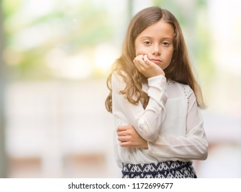 Brunette hispanic girl thinking looking tired and bored with depression problems with crossed arms.