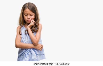 Brunette hispanic girl touching mouth with hand with painful expression because of toothache or dental illness on teeth. Dentist concept.