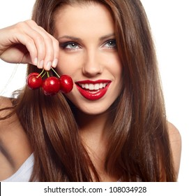 brunette holding cherryes, close up, looking at camera