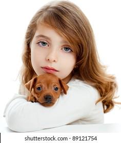 Brunette kid girl with puppy dog mascot mini pinscher on white background