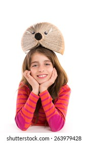 Brunette kid girl student with hedgehog book on white background