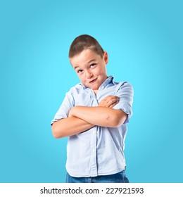 Brunette kid over isolated blue background