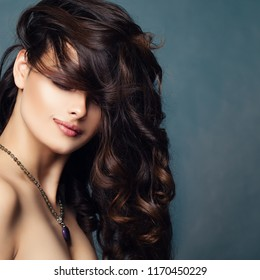 Brunette lady with permed hair. Gorgeous woman with curly hairstyle